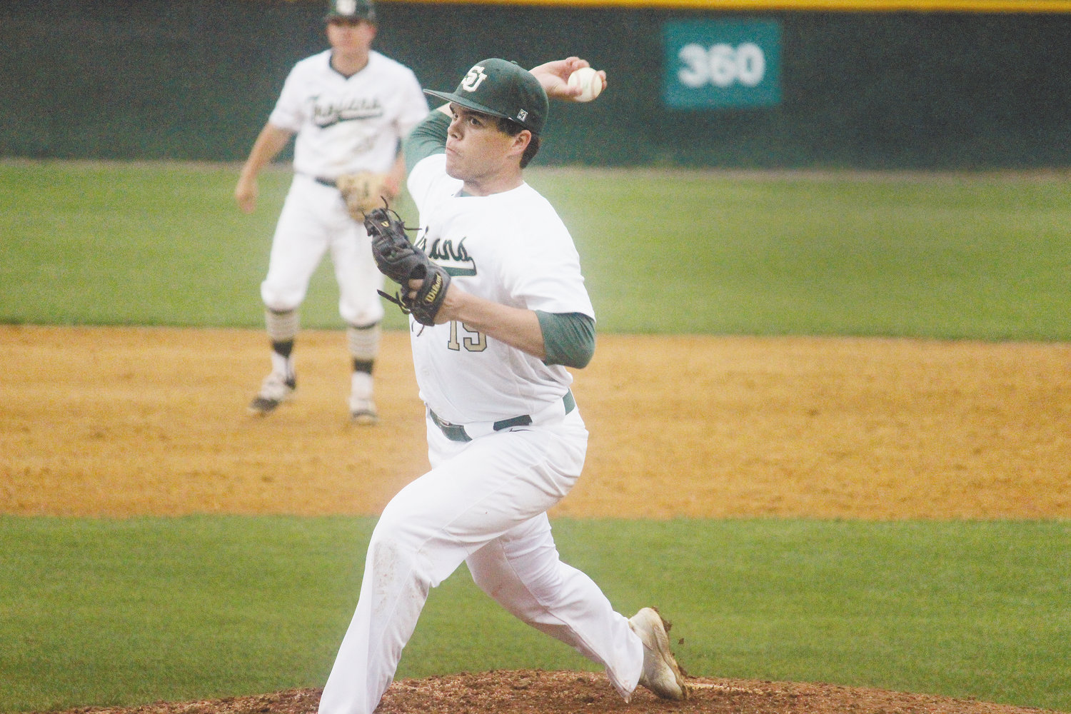 Justin Hamilton whips in a pitch against East Wake on Friday. The South Johnston junior tossed six innings and gave up just one run in the Trojans' 6-1 win.