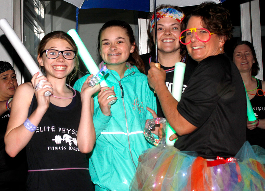 People stood outside Friday in the 