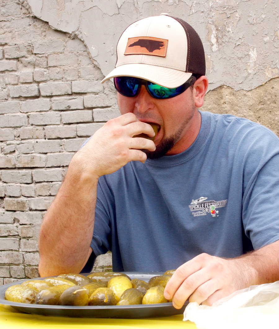 Sean Strickland also takes on the pickle eating challenge during the pickle festival.