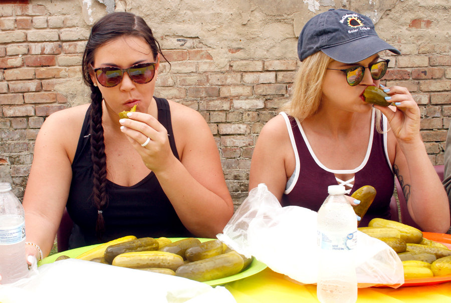 Kodi Smith and Samantha Summerlin take on the pickle eating challenge during the North Carolina Pickle Festival Saturday.