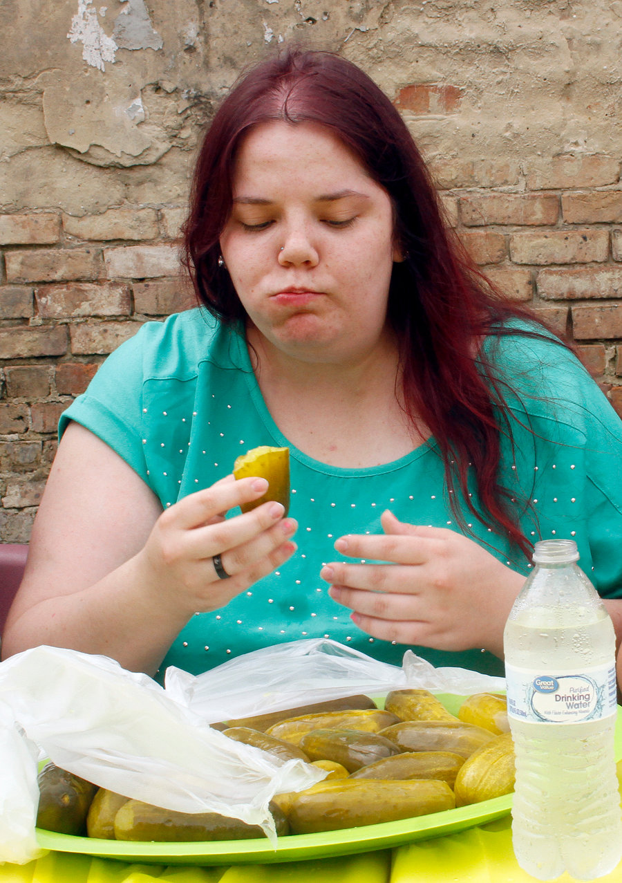 Patricia Davis eats one of the twenty pickles during the five minutes of the pickle eating challenge Saturday.