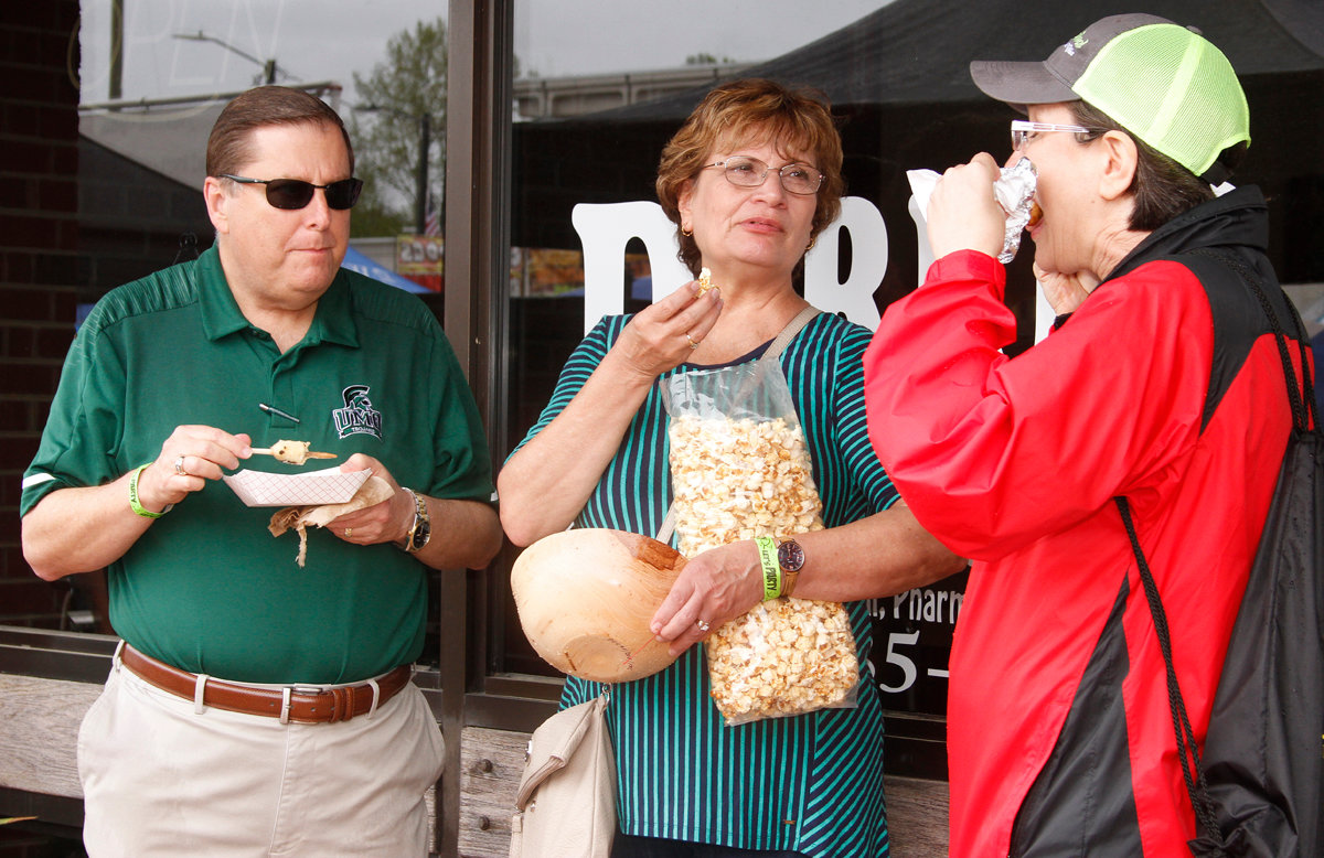 UMO President Dr. David Poole and his wife Mary Poole along with Co-Chairman Lynn Williams of the North Carolina Pickle Festival take a few minutes to enjoy some food and fellowship Saturday afternoon.