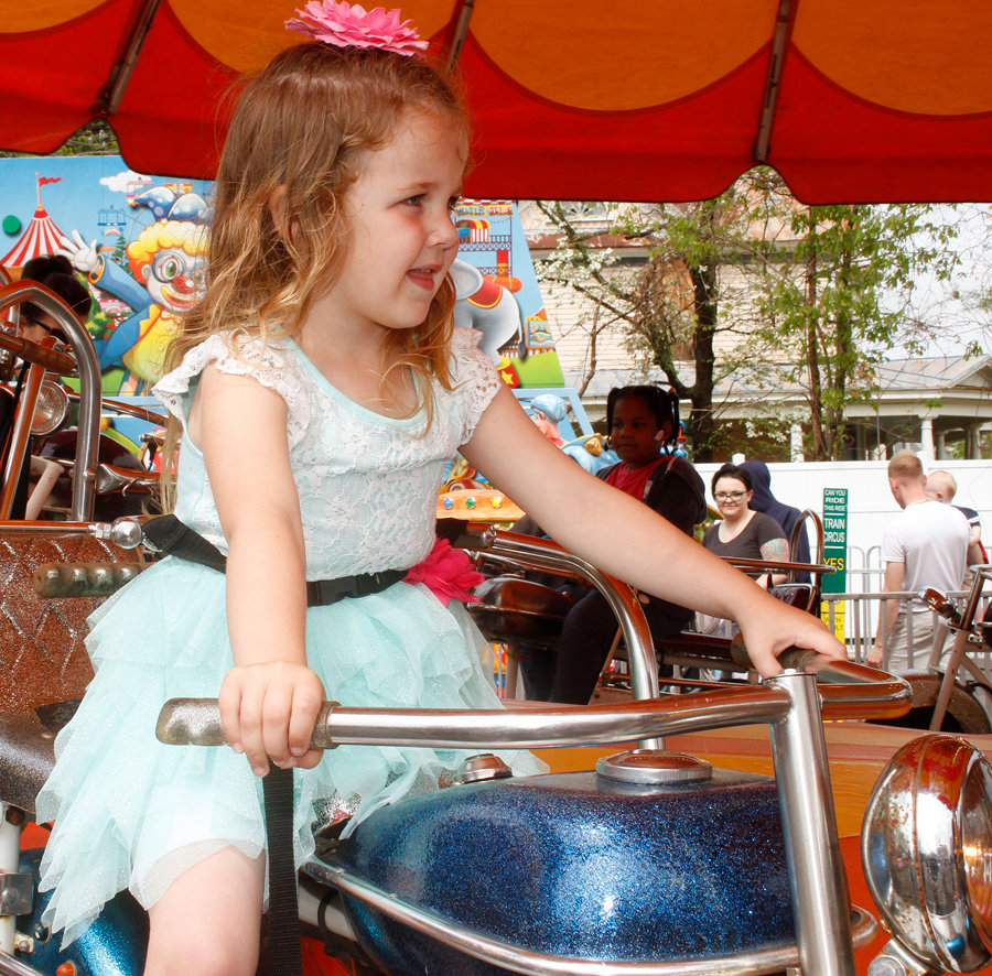 Ruth Harris (4) was having a great time on some of the rides during her visit to the North Carolina Pickle Festival 