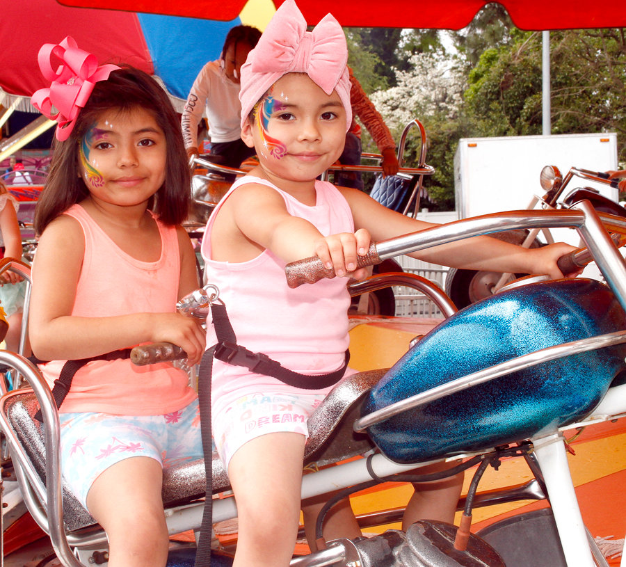 Jackie Reyes and her sister Estella Reyes take their turn on one of the rides during the North Carolina Pickle 