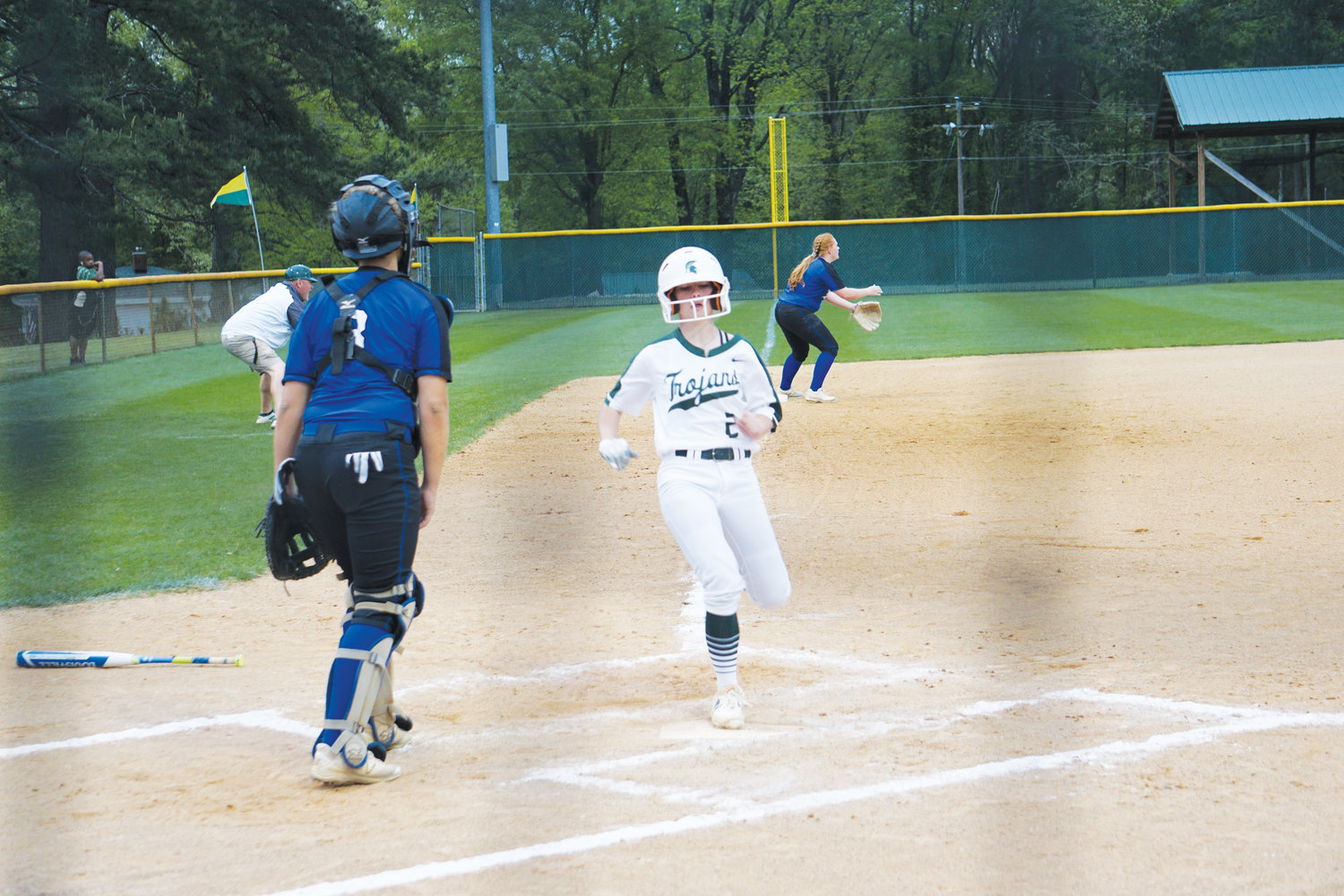 South Johnston's Katie Mitchell scores the first run of the game Wednesday evening against Clayton. She also batted in another run later in the Trojans' 4-2 loss.