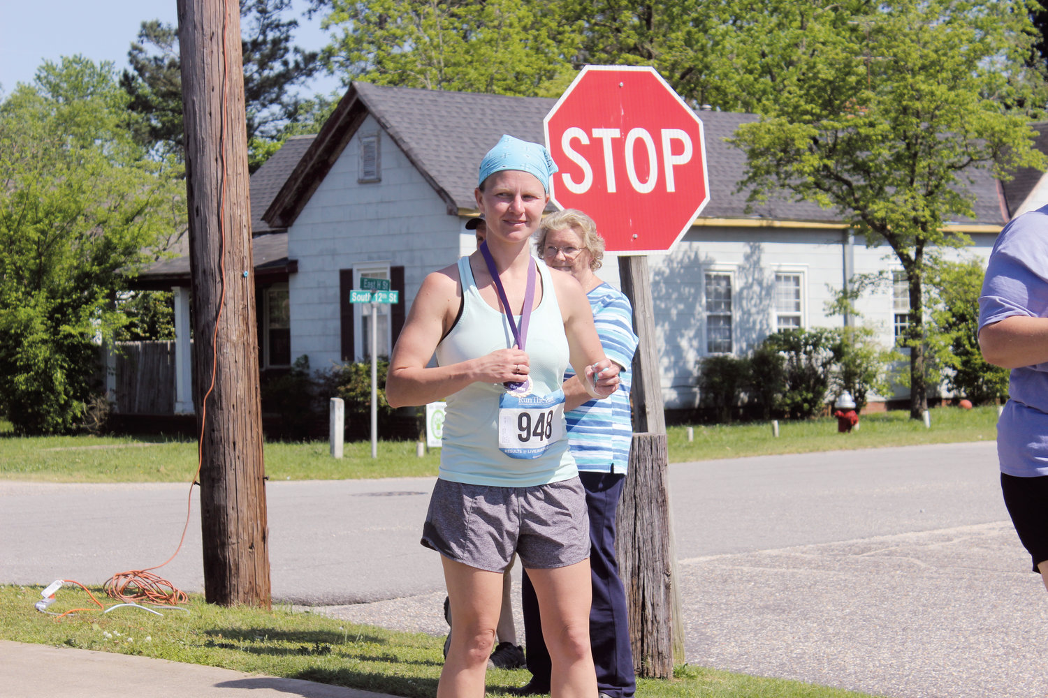 Jilene Brooks stands with her medal after being the first female to finish in this year's RailTrail Run.