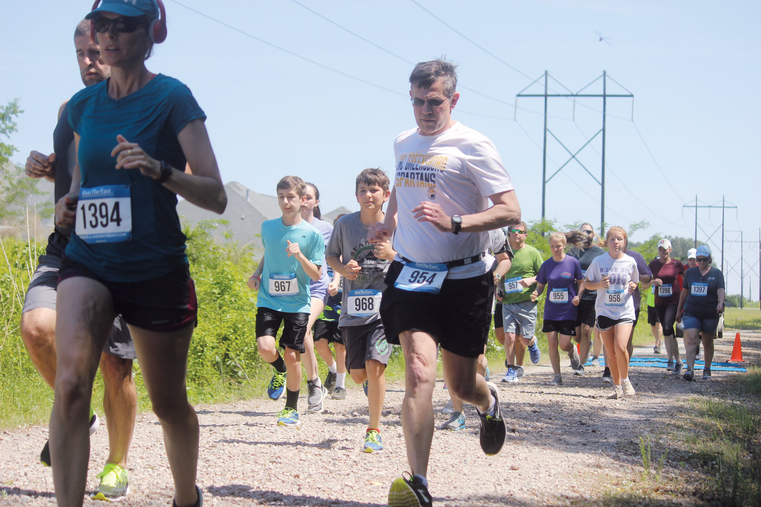 Participants of all ages and speeds make their way down the RailTrail Run in Erwin.