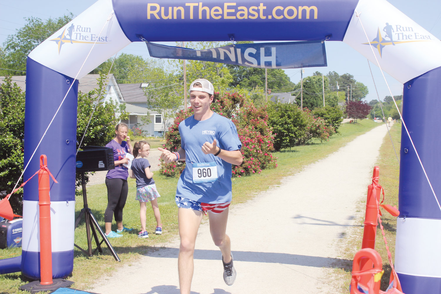 Kyle Hadding crosses the line to win the RailTrail Run for CareNet in Erwin on Sunday.