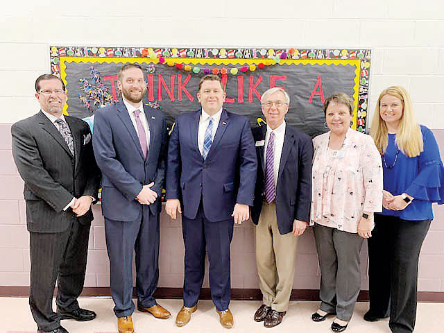 Pictured from left are Harnett County Schools Learning Community Director Chris Mace, Harnett County Schools CTE Director Justin Wilkinson, Harnett County Schools Superintendent Dr. Aaron Fleming, Owner/CEO of Paxton-Patterson Roger Davis, Dunn Middle School Principal,Dr. Janet Doffermyre, and Dunn Middle School Assistant Principal Megan West.