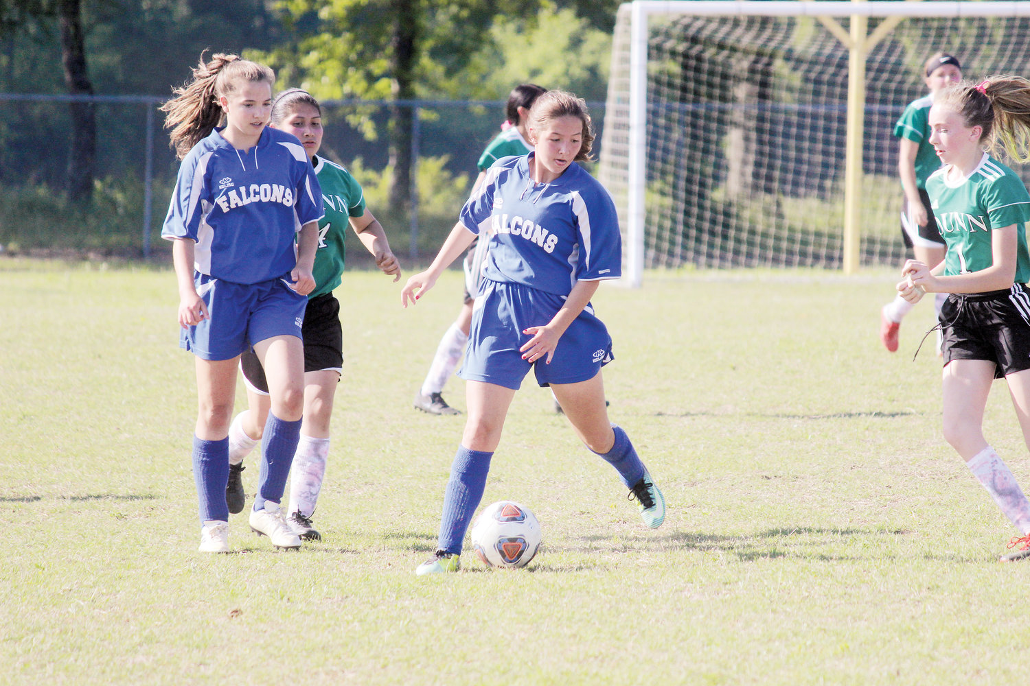McKenna Moore dribbles through the pressure. Moore scored two goals for Coats-Erwin in the Falcons' 3-0 win at Dunn.