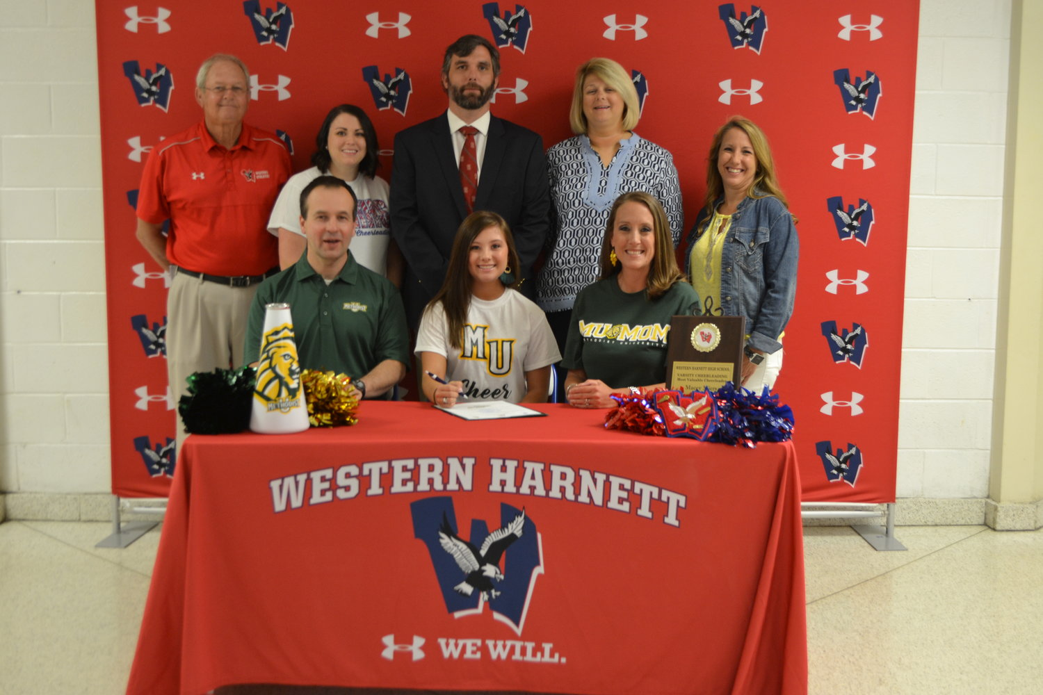 Western senior signs to cheer in college.