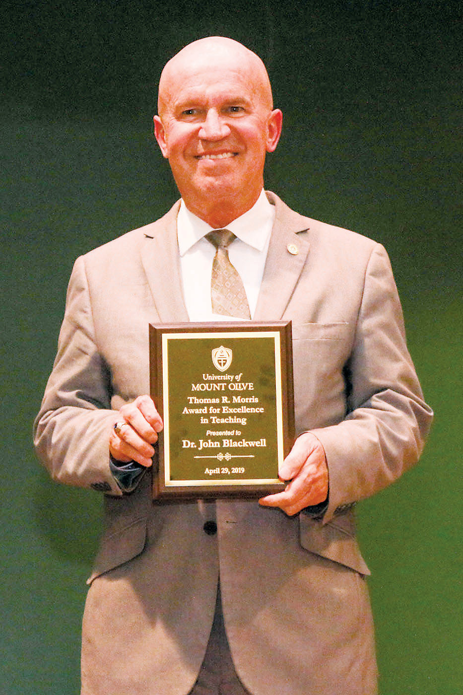 Dr. John Blackwell is honored with the Thomas R. Morris Award at the University of Mount Olive.