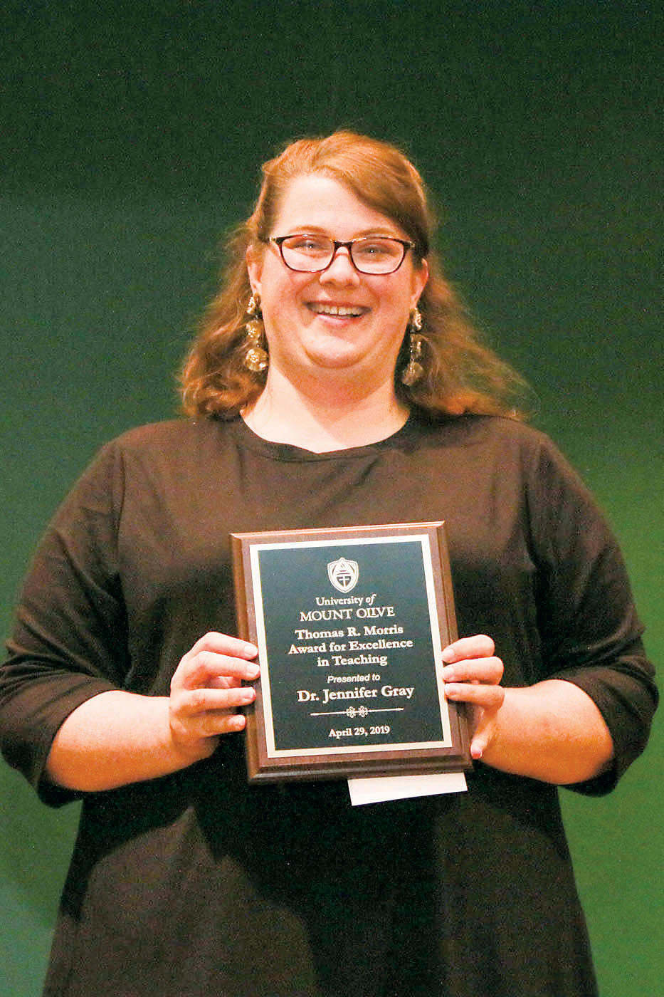 Dr. Jennifer Gray is honored with the Thomas R. Morris Award at the University of Mount Olive.