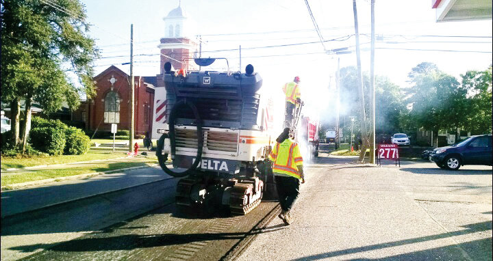 A crew with the North Carolina Department of Transportation works on Breazeale Avenue near Main Street. The resurfacing project began two weeks ago.