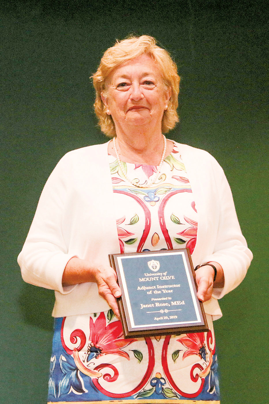 Janet Rose of Calypso is pictured with her award, having received the 2019 Adjunct Instructor of the Year Award at the University of Mount Olive.