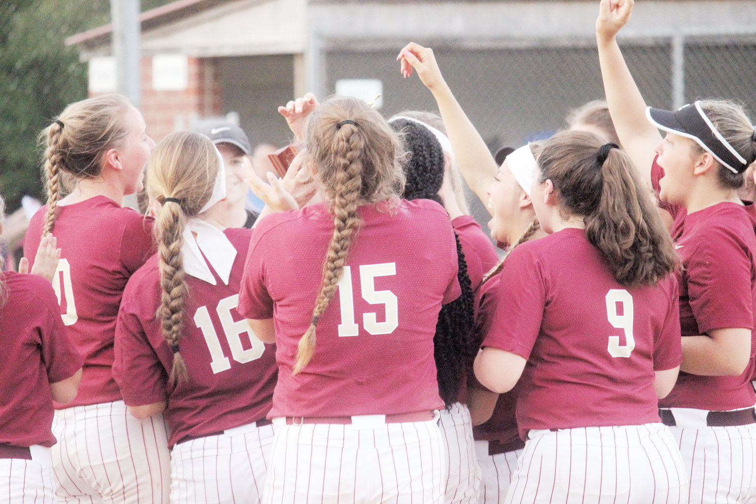 Harnett Central softball players celebrate after winning the Tri-County Conference Tournament earlier this season. The Trojans advanced to third round of the NCHSAA 3A playoffs and will play at D.H. Conley on Tuesday.