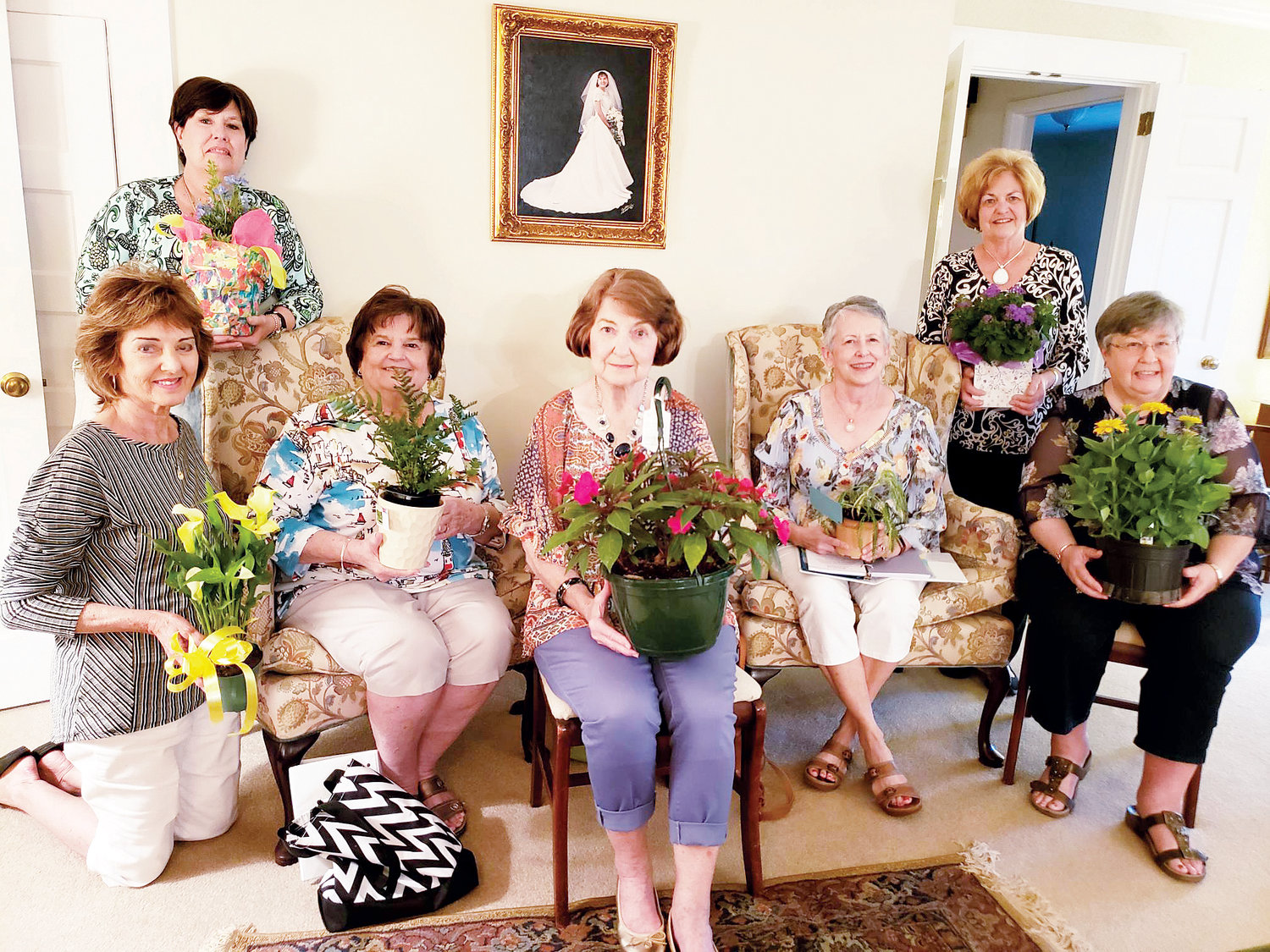 Just-A-Mere Garden Club members assemble with their plants that they received in the night's plant swap. Pictured in front, from left, are Rachel Edwards, Dixie Honeycut, Betty Lee, Beverly Best and Betsy Williams. Standing are Catherine Gilmore and Karene Smith. Not pictured is Rita Wilson.