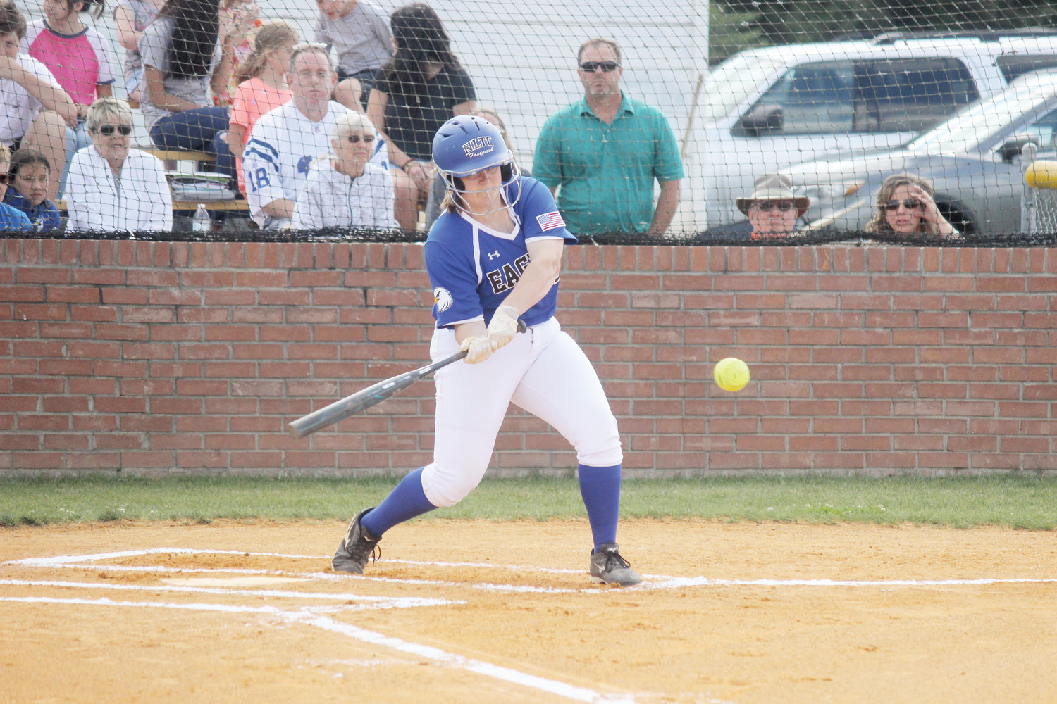 Cape Fear Christian Academy's Kristen Bass swings on a pitch during a game last season. The NCHSAA announced its decision to extend the statewide hold on all interscholastic athletics until May 15.