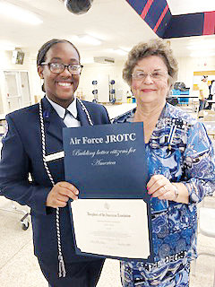 Award winner this year was a senior, Cadet Sasha Johnston, left, from Southern Wayne High School. Presenting the award is Judi Herring of the Carolina Patriots DAR Chapter in Mount Olive.