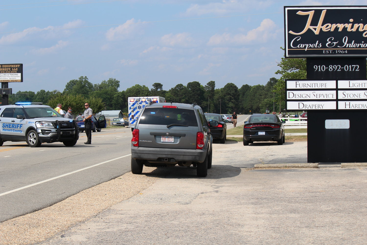Harnett County Sheriff's Office deputies investigate the scene of a deadly shooting along U.S. Highway 301 North Wednesday afternoon in the Mary Stewart Community between Dunn and Benson.