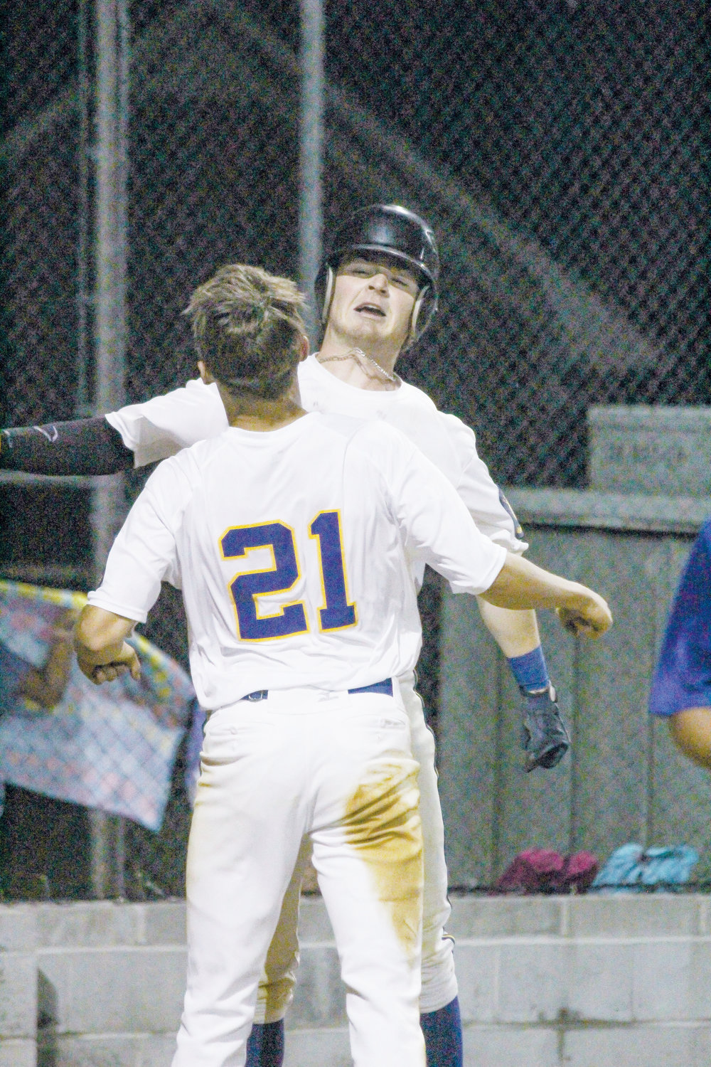 Christian Yarbrough and Blake Dilda celebrate after Yarbrough slides under the tag to win against Wilson Post 13, 3-2.