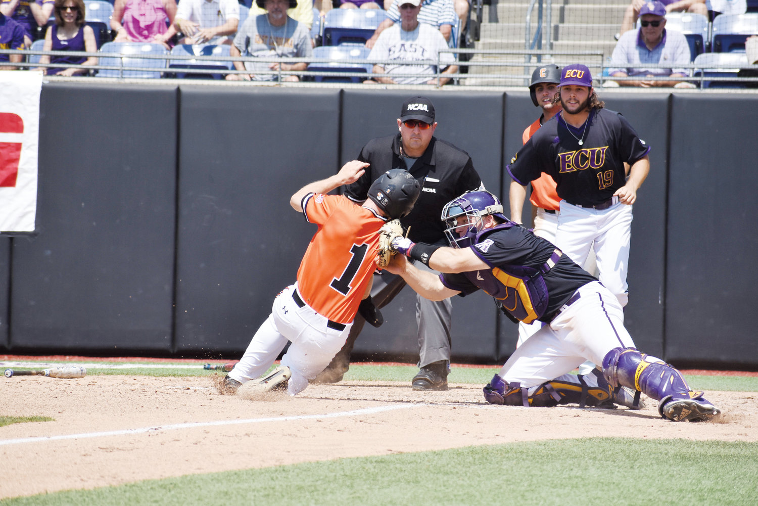 East Carolina catcher Jake Washer tags out Campbell's Grant Harris attempting to score at the plate in the fourth inning of Monday's first game at Clark-LeClair Stadium in Greenville. Washer was named Most Outstanding Player of the Greenville Regional.