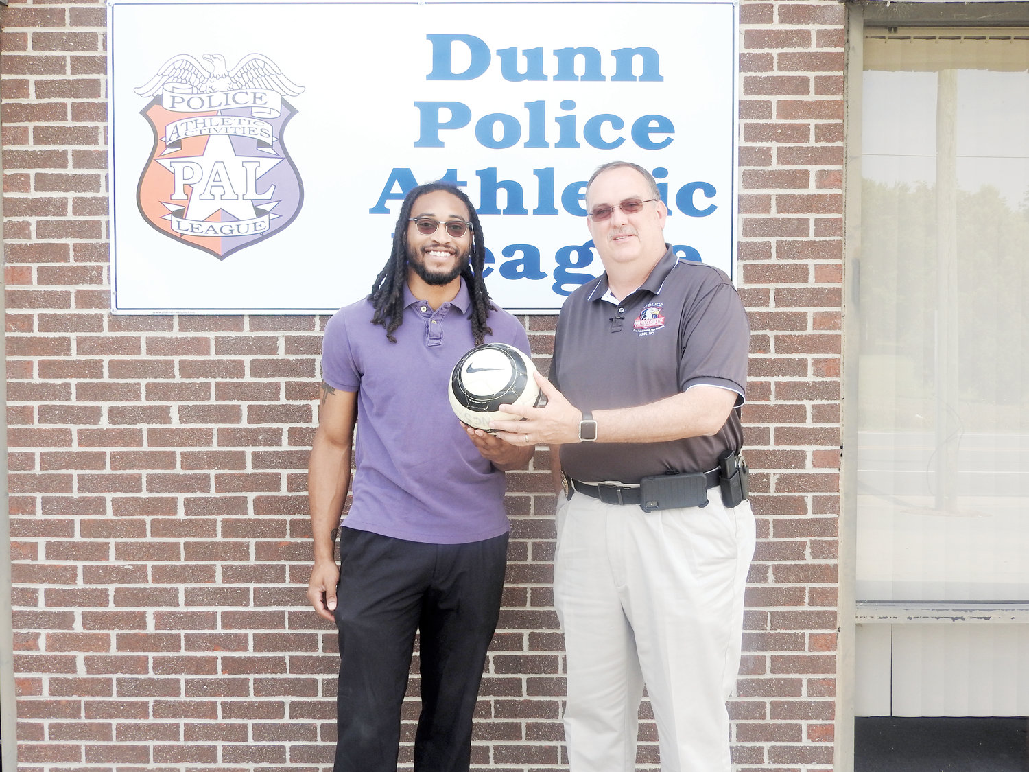 Dunn PAL Soccer Program Director Jonathan Bridges and Executive Director Rodney Rowland, right, pose together outside the Dunn PAL office. They'll be working together to start up PAL's new soccer program this summer.