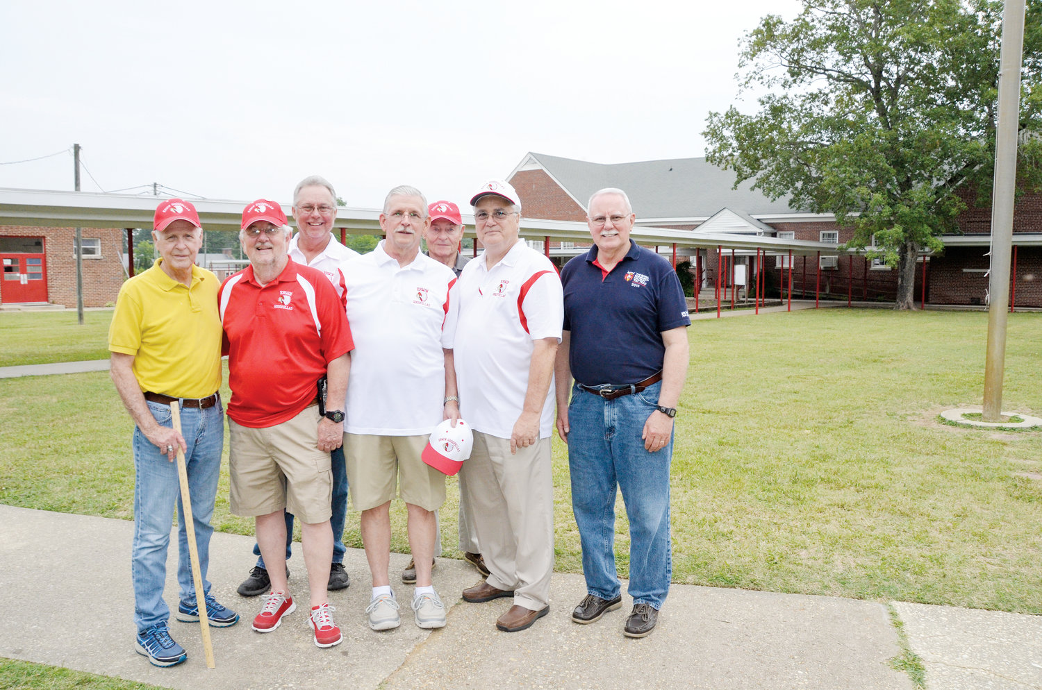 A group of Erwin High School alumni pose for a photo during the open house and final walk-through tour of Erwin Elementary School Thursday. Pictured, in front from left, Glenn Wade (class of '54), Jim Wade (class of '64), Ron Miriello (class of '64), Si Harrington III (class of '67) and Eddy Blackman (class of '72); back row, Dennis Avery (class of '82) and Tony Godwin (class of '66). The elementary school campus was the former location of the high school prior to the consolidation of Erwin, Coats and Dunn High Schools, forming Triton High School in 1985.