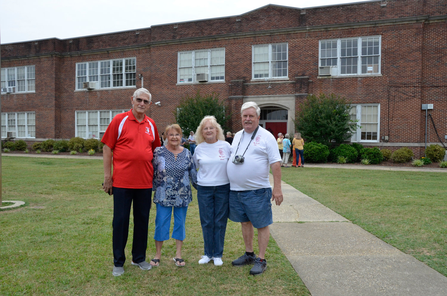 High school friends, from left, Jim and Jean Bradley of Erwin and Connie and Mike Johnson of Coats join a large crowd Thursday for a final walk through of their alma mater. Mr. and Mrs. Bradley graduated in 1966 and Mrs. Johnson in 1968.