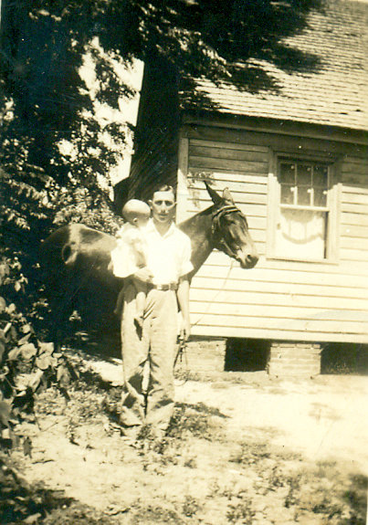 Dorothy Jean Barefoot with her father, Dalton Pope, and their mule in 1942.