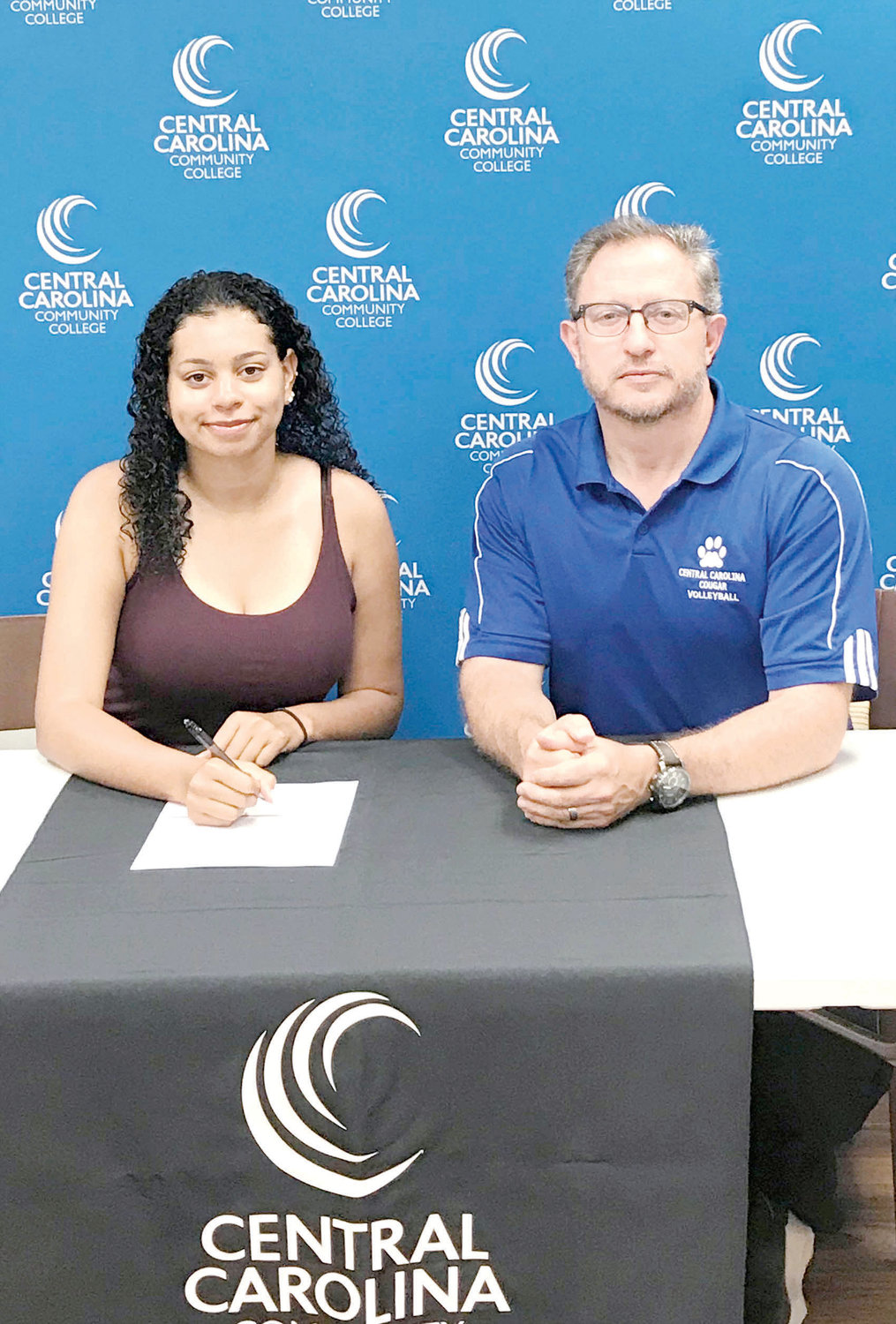 Kayla Stange, left, who attended Overhills High School, will join the Central Carolina Community College volleyball program. She is pictured with CCCC volleyball coach Bill Carter.