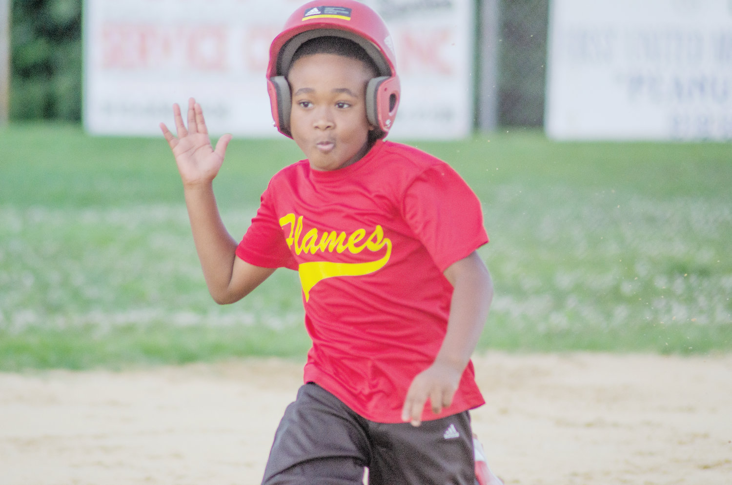 Xion Atkins of the Mount Olive Flames runs to third base during the Flames' game against Spring Creek on Tuesday, June 11.