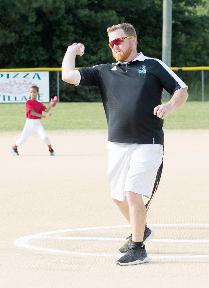 Special Guests throw out first pitches at 8U Baseball tournament .University of Mount Olive Baseball head coach Rob Watt throws out the first pitch at one of the games on June 17 at the Wayne County 8U Baseball tournament. The baseball tournament was held at Daughtry Field in Mount Olive.