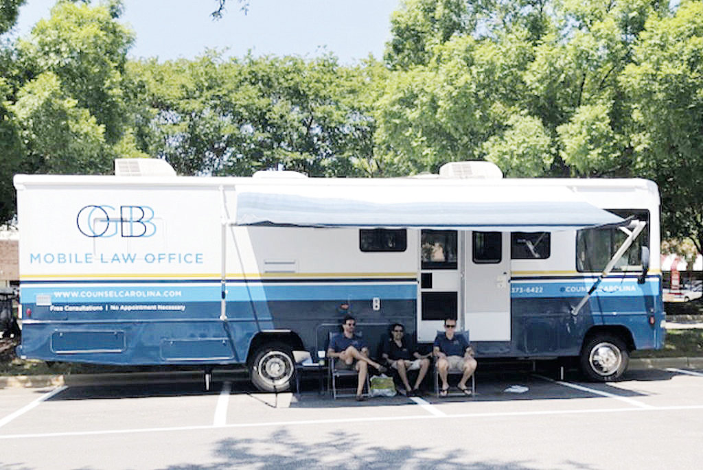 Attorneys offer legal services to poor from RV | The Daily
