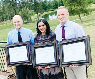 Pictured from left are Family Medicine graduates Dr. Steve Jones, Dr. Rita Mikhail-Vaswani and Dr. Keith Burke.