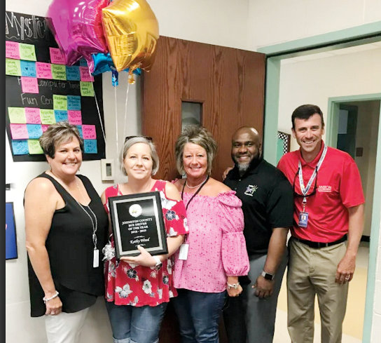 Johnston County Public Schools named West Johnston area bus driver Kathy Wood as the 2019 Bus Driver of the Year. Pictured from left are JCPS Director of Transportation Supervisor Sherrie Turnage, JCPS 2019 Bus Driver of the Year Kathy Wood, JCPS Bus Coordinator for the West Johnston area Kim Smith, Dixon Road Elementary Principal Kenneth Bennett, and JCPS Auxiliary Services and Safety Officer Chase Ferrell.
