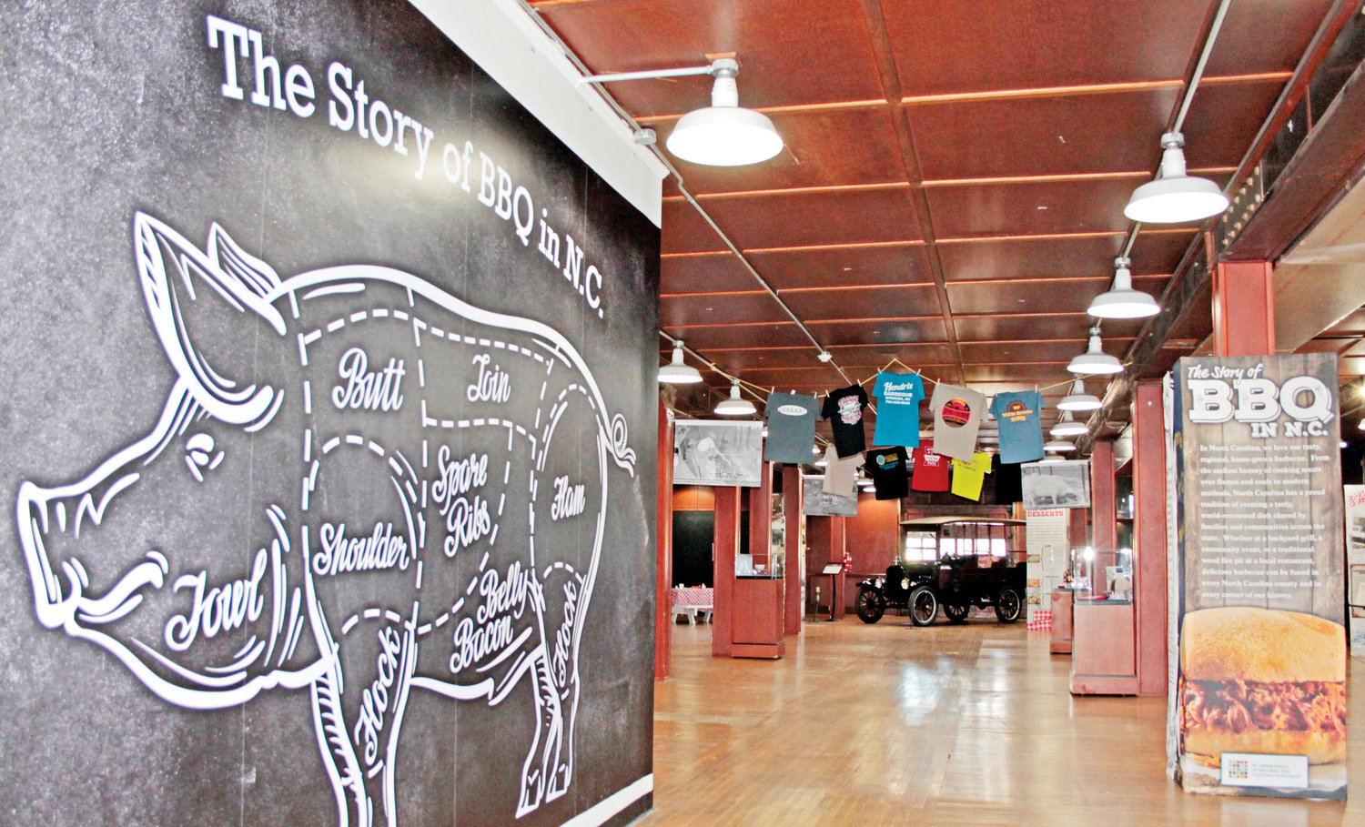 'The Story of BBQ in North Carolina' is on display at the N.C. Transportation Museum in Spencer. It explores the emergence of hog cultivation and food made from them as a centerpiece of many gatherings..