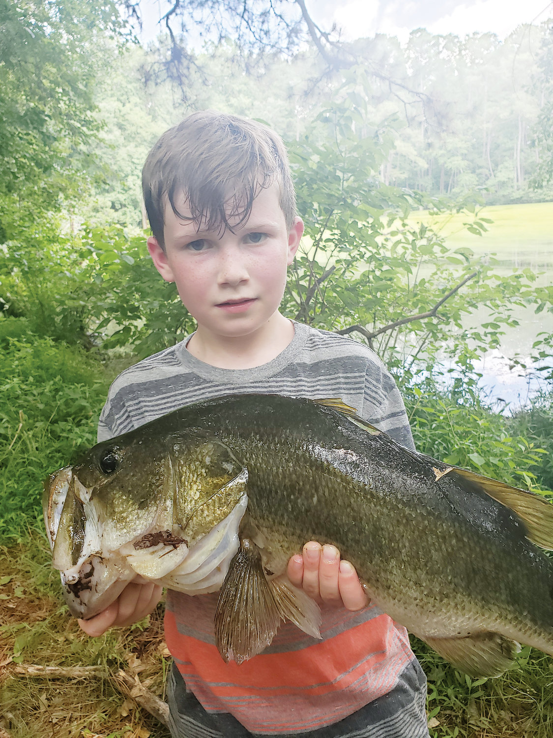 Landon Sharpe, son of Bryan and Lauren Sharpe of Dunn, caught a nice largemouth bass at an undisclosed location in Dunn on Saturday. He used a culprit worm from the Erwin Fish Box. 'He's 9 years old and is already the best fisherman in a family full of fishermen,' his father said. 'We released it. We are big on letting the big ones go so they can be caught again.'