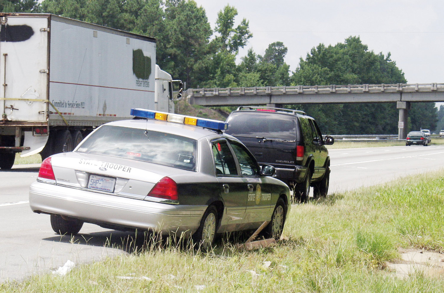 A Highway Patrol trooper pulls over a car in a crack down on speeders in 2004.