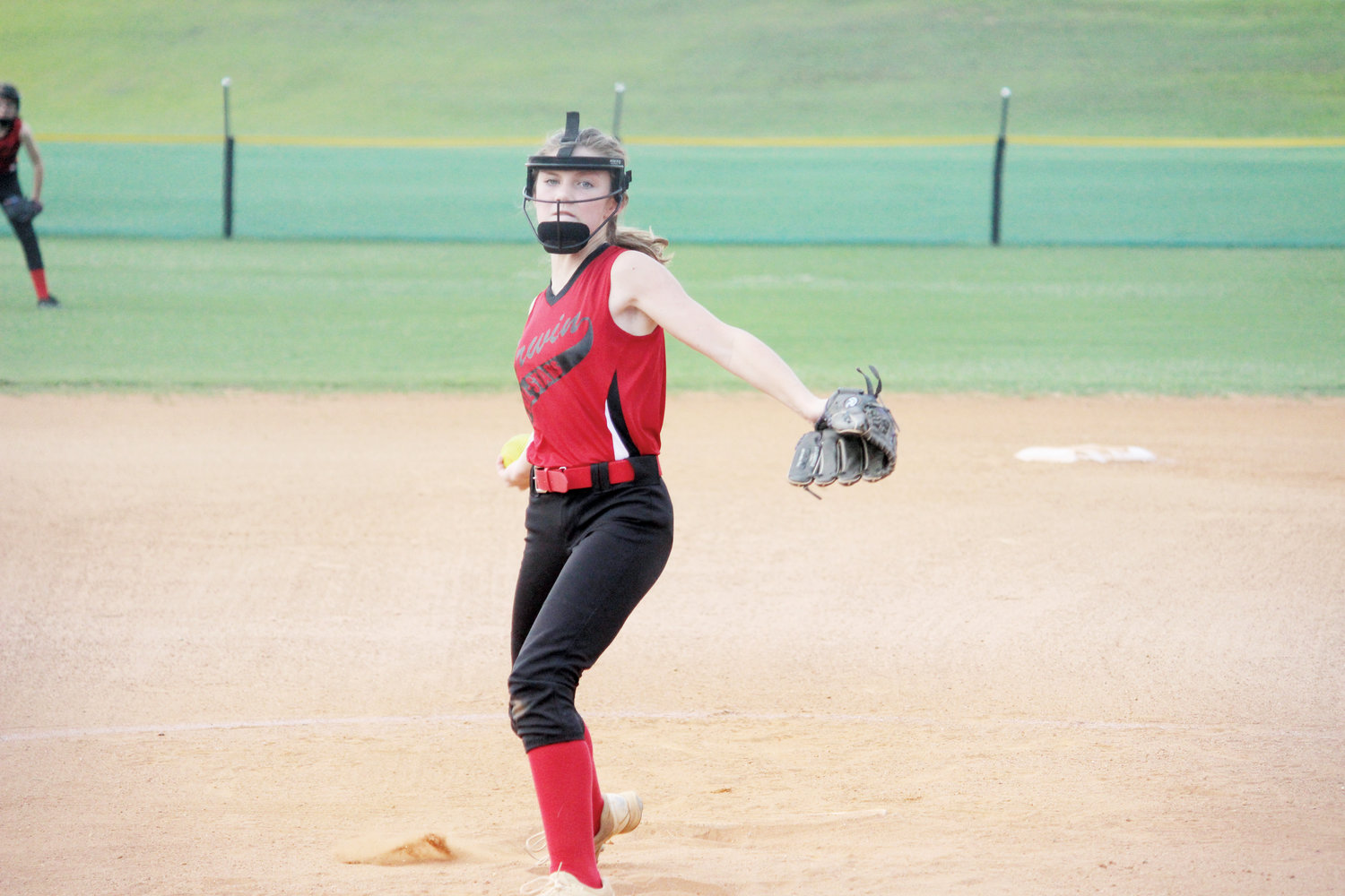 Sydney Bradham fires a pitch on Thursday. Bradham pitched the entire tournament for Erwin, helping guide her team to the District IV championship.
