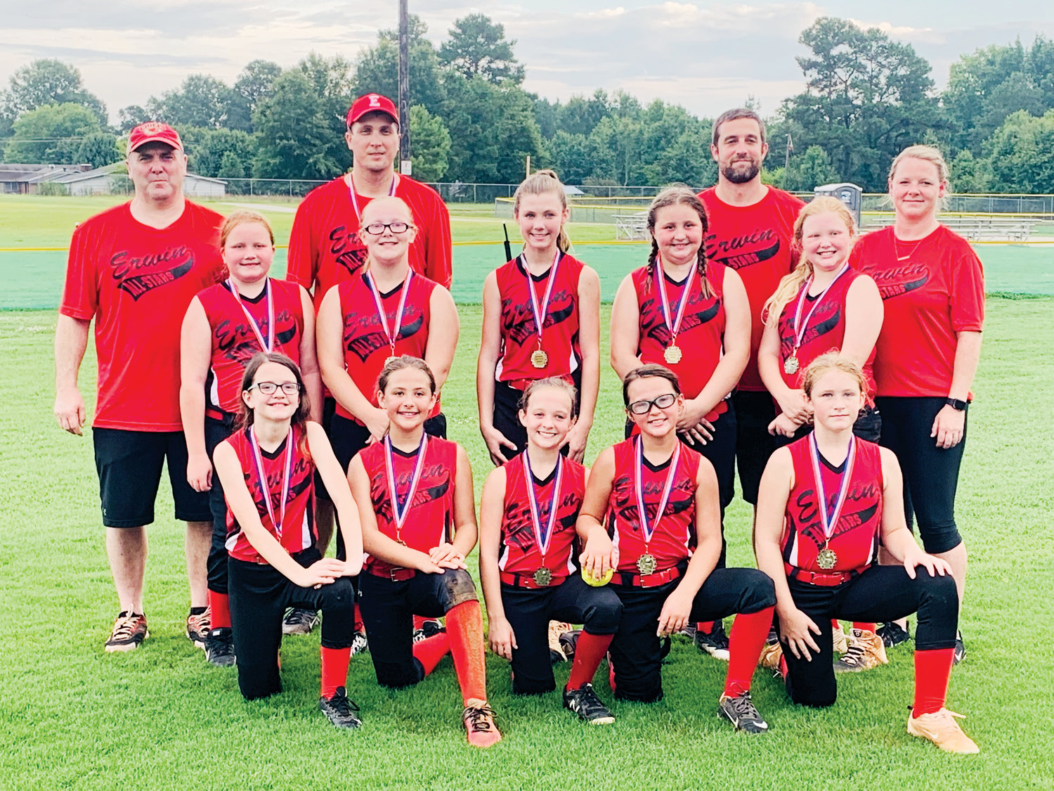 Erwin's 10-and-under softball team won the Tar Heel District III tournament this past weekend in Erwin. Kneeling, from left, are Paisleigh Lucas, Bryleigh Smith, Grace Foisy, Megan Harrold and Charley Beasley. Standing in front are Peyton Dunn, Adison Bowden, Sydney Bradham, Mackenzie Lucas and Leigha Roberts. Standing in the back are coach David Bradham, coach Travis Pollard, coach John Paul Foisy and coach Amy Foisy.