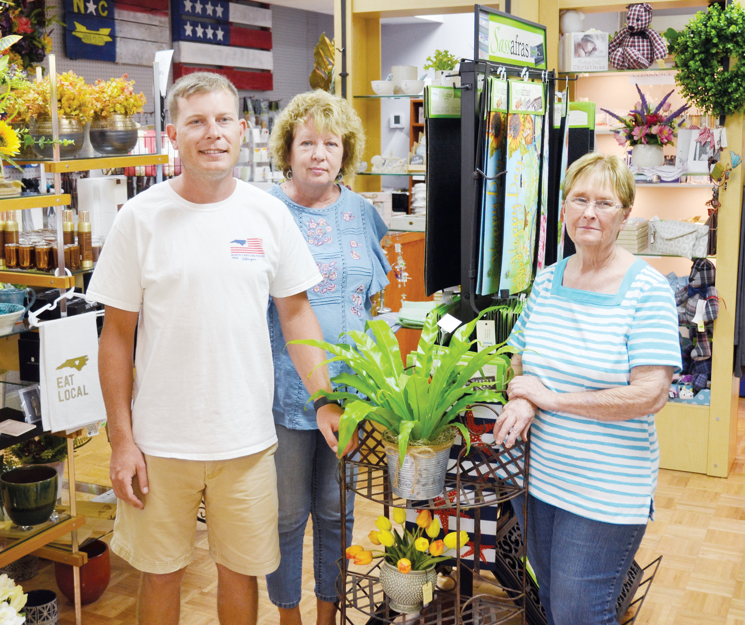 Matt Brown has opened The Flower Pot at 29 W. Front St. in Lillington. Included in the staff of the floral and gift shop are his mother Beverly (center) and Ann Gregory who also does designing along with Brown.