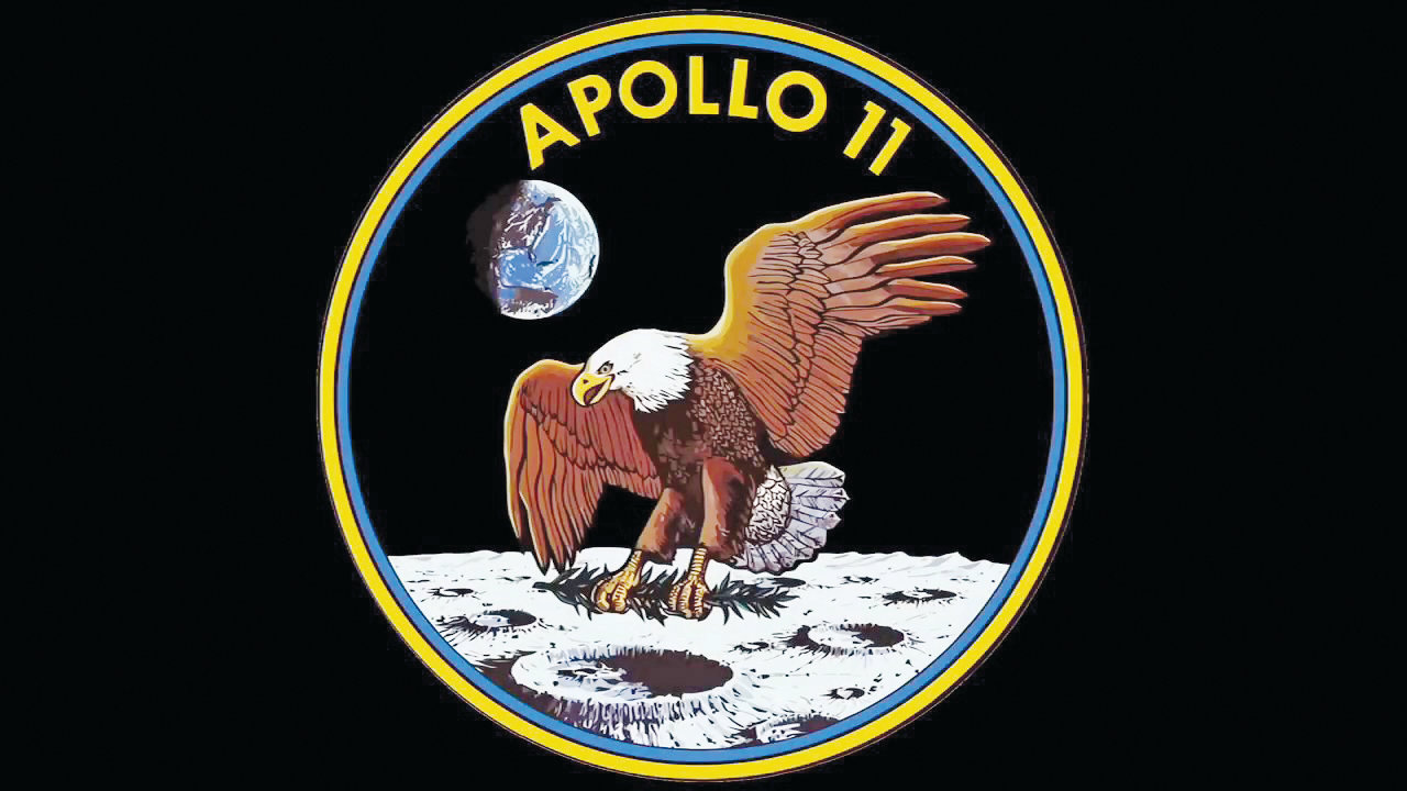 The distinct crew patch of the flight of Apollo 11 showing an eagle touching the moon with the Earth in the background was designed by command module pilot Michael Collins. It was the only such patch during the Apollo Project not to display the names of the crew.