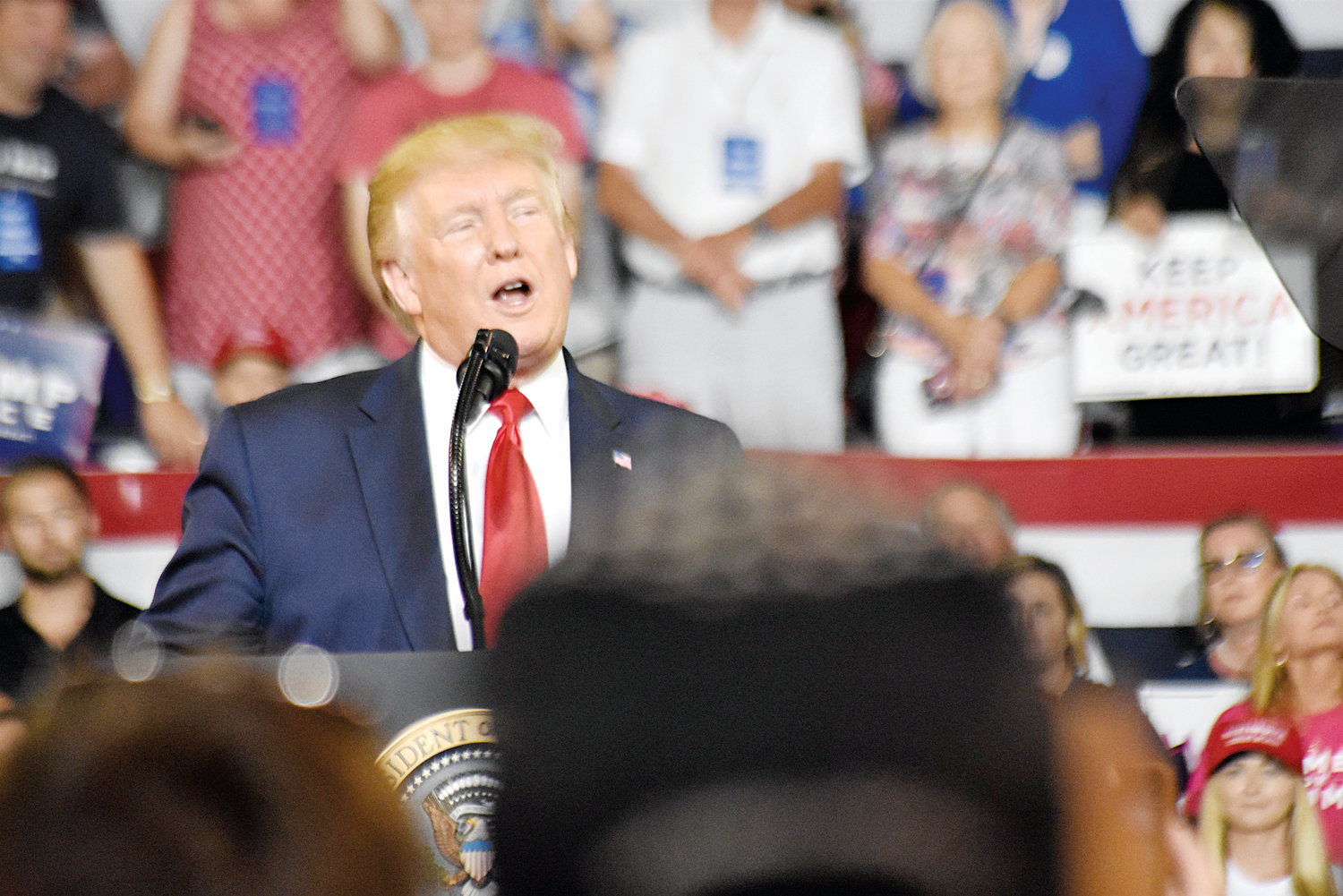 President Donald Trump addresses the crowd during a Keep America Great campaign rally Wednesday at East Carolina University's Minges Coliseum.