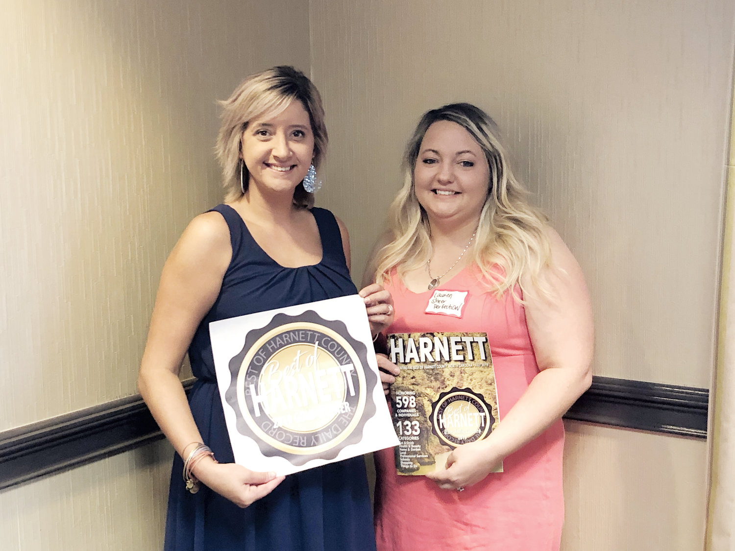 Sheer Perfection owner and stylist Crystal Jones, left, stands with hair stylist Lauren LaFromboise with the Best of Harnett award the salon won.