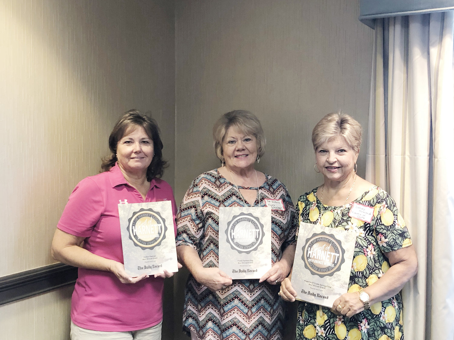 From left, Dunn Tourism Executive Director Sharon Stevens, Pat Godwin of the Coats Chamber of Commerce and Sandy Howard of the Kiwanis of Coats stand with the awards they won in this year's Best of Harnett contest.