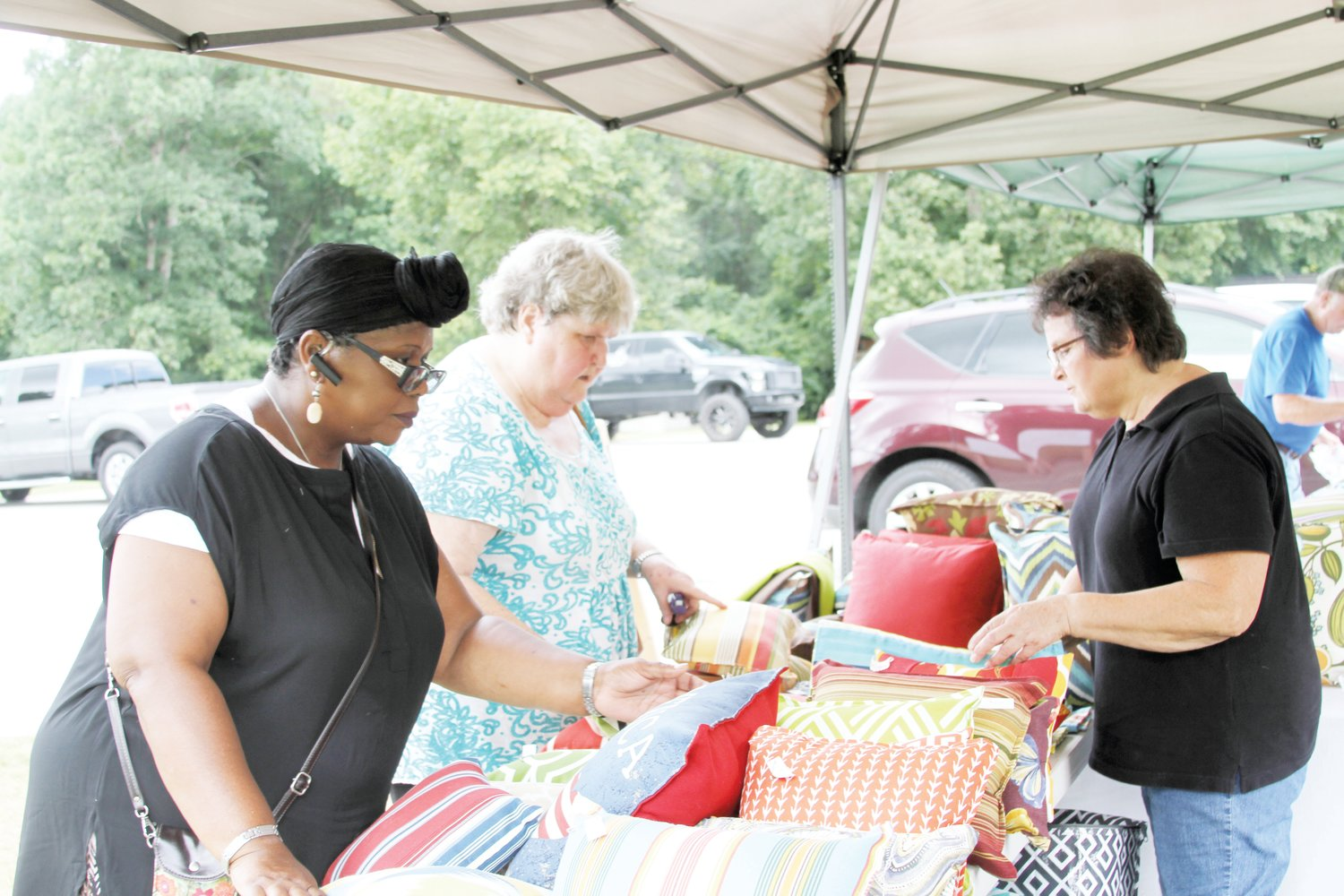 Shoppers look through assorted pillows during the Maxwell Road Endless Yard Sale in 2017. The event, now in its fifth year, will be held Saturday in Sampson and Cumberland counties.