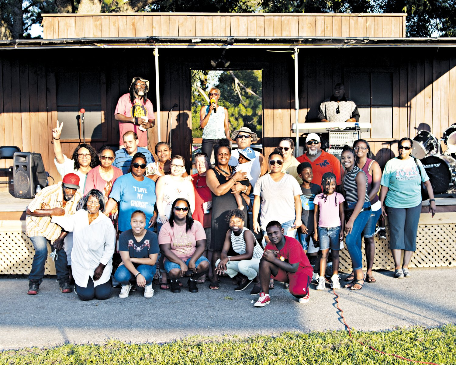Pastor Rhonda Ray, center, poses for a group photo with community members and the congregation of Grazing Mountain Church.