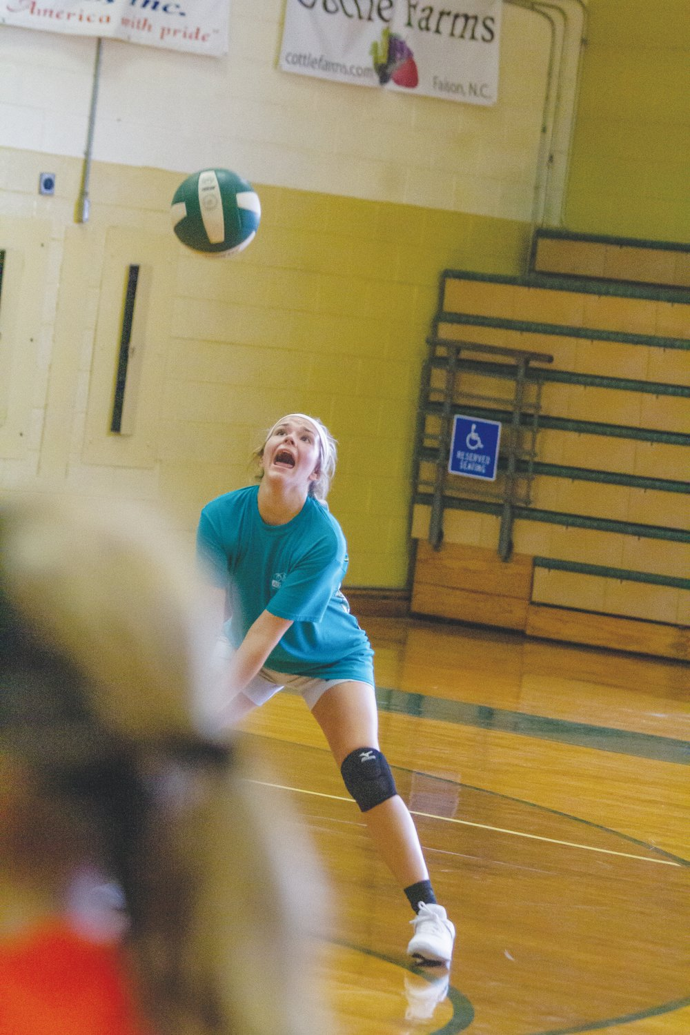 Logan Rae Jones communicates with her teammates as she sets up to hit the ball over the net during practice.