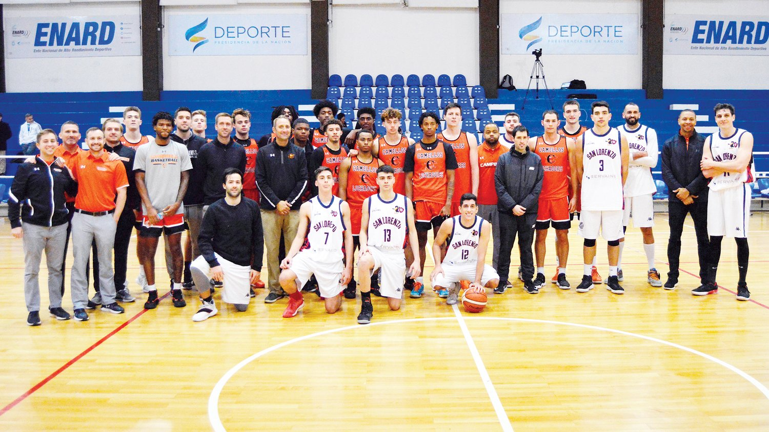 Campbell's men's basketball team gathers with players from Buenos Aires after the opening game of the Camels' South American tour on Monday.